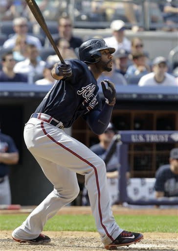 Atlanta Braves' Jason Heyward hits a two-run home run off New York Yankees relief pitcher Boone Logan during the eighth inning of a baseball game at Yankee Stadium in New York, Wednesday, June 20, 2012. (AP Photo/Kathy Willens)