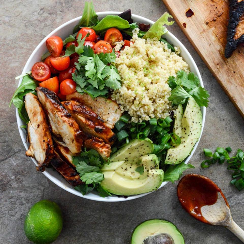 "<p>Buddha bowls often get their protein from beans, but these <a href=""http://www.howsweeteats.com/2014/01/honey-chipotle-chicken-bowls/"" target=""_blank"">Honey Chipotle Chicken Bowls</a> use chipotle-flavored chicken breasts instead. Lime-infused quinoa provides a fresh zip to the greens, avocado, and tomatoes. (Get more creative with your cooking and try these <a href=""https://www.shape.com/healthy-eating/healthy-recipes/easy-chicken-dinner-ideas"" target=""_blank"">easy chicken recipes that are actually healthy</a>.)</p>"