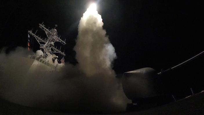 <p>The guided-missile destroyer Porter launches a Tomahawk missile on April 7, 2017, at a Syrian air base. (U.S. Navy via AP) </p>