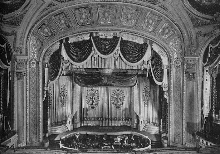 """<p>The Tivoli Theatre opened in the 1920s. It was the first of the """"big three"""" movie palaces in the area. Tivoli closed in 1963 and was demolished soon after. </p>"""