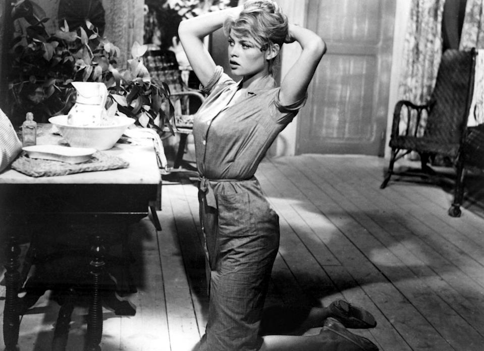 """<p>This 1956 erotic drama stars Brigitte Bardot as a young wife who loves one brother but marries the other. This flick got her a household name and coined her as the generation's """"sex kitten."""" You'll see why . . .</p> <p>Watch <a href=""""https://play.hbomax.com/page/urn:hbo:page:GXnAn2wD-Bp4_wwEAAElH:type:feature"""" class=""""link rapid-noclick-resp"""" rel=""""nofollow noopener"""" target=""""_blank"""" data-ylk=""""slk:And God Created Woman""""><strong>And God Created Woman</strong></a> on HBO Max now.</p>"""