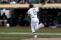 Oakland Athletics' Mark Canha gestures after hitting an RBI for a walk-off win against the Houston Astros in the ninth inning of a baseball game in Oakland, Calif., Sunday, Sept. 26, 2021. (AP Photo/John Hefti)