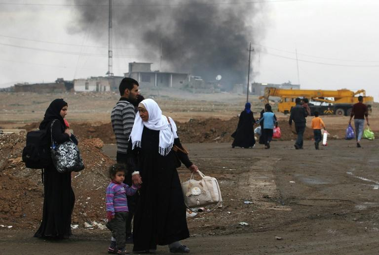 Displaced residents of western Mosul on March 15, 2017, as Iraqi forces continue their advance against the Islamic State group