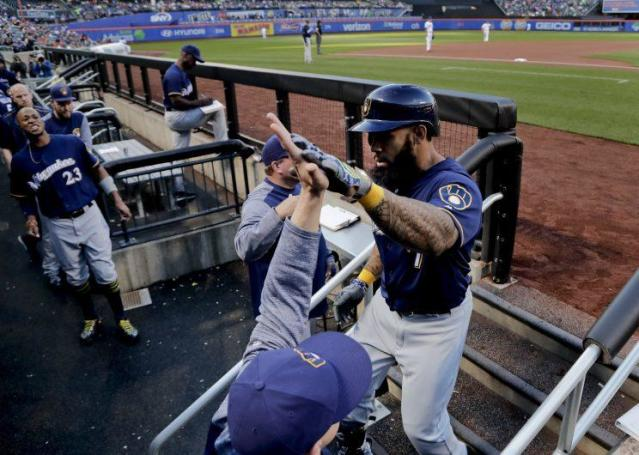 Eric Thames high fives teammates after hitting his first home run in three weeks, not long before he's drug tested for at least the fourth time in six weeks. (AP Photo)