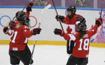 Brianne Jenner of Canada (19) celebrates her goal against the United States with her teammates Haley Irwin (21) and Catherine Ward (18) during the third period of the women's gold medal ice hockey game at the 2014 Winter Olympics, Thursday, Feb. 20, 2014, in Sochi, Russia. (AP Photo/Petr David Josek)