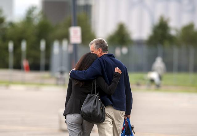 "Larry Trujillo (R), Denver's former fire chief and Colorado's director of Homeland Security, walks out of Arapahoe County District Court with his wife Michelle Trujillo in Centennial, Colorado April 27, 2015. The Trujillo's daughter Tayler Trujillo was uninjured when she fled the gunfire in the Aurora Shootings. Colorado's long-awaited cinema massacre trial began on Monday with opening statements in which jurors were asked to decide whether gunman James Holmes was insane when he killed a dozen moviegoers in 2012, or a calculating mass murderer who deserves execution. Holmes pleaded not guilty by reason of insanity to multiple charges of murder and attempted murder for opening fire inside a midnight screening of a ""Batman"" movie at a Denver-area multiplex in July 2012. Twelve people were killed and another 70 were wounded in the shooting. REUTERS/Evan Semon"
