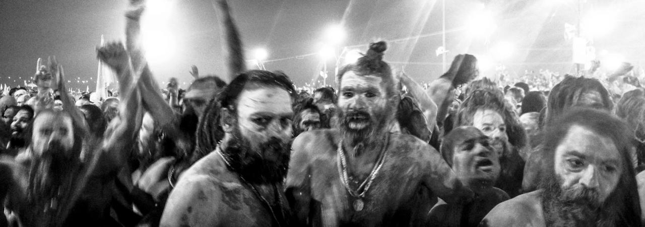 ALLAHABAD, INDIA - FEBRUARY 10: (EDITORS NOTE: Image was created using the iPhone panoramic application) Naga Sadhus, naked Hindu holy men, walk in procession after having bathed on the banks of Sangam, the confluence of the holy rivers Ganges, Yamuna and the mythical Saraswati, on the auspicious bathing day of Mauni Amavasya during the Maha Kumbh Mela on February 10, 2013 in Allahabad, India. The Maha Kumbh Mela, believed to be the largest religious gathering on earth is held every 12 years on the banks of Sangam, the confluence of the holy rivers Ganga, Yamuna and the mythical Saraswati. The Kumbh Mela alternates between the cities of Nasik, Allahabad, Ujjain and Haridwar every three years. The Maha Kumbh Mela celebrated at the holy site of Sangam in Allahabad, is the largest and holiest, celebrated over 55 days, it is expected to attract over 100 million people who will bathe in holy waters to wash away their sins. (Photo by Daniel Berehulak/Getty Images)