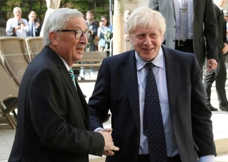British Prime Minister Boris Johnson shakes hands with European Commission President Jean-Claude Juncker during a meeting in Luxembourg