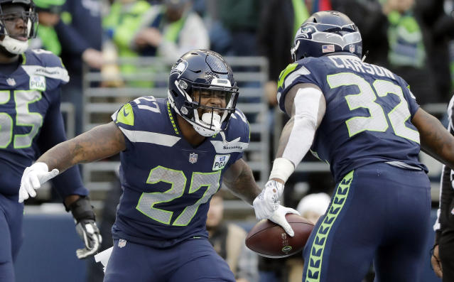 Seattle Seahawks' Mike Davis (27) celebrates his touchdown with Chris Carson during the second half of an NFL football game against the Arizona Cardinals, Sunday, Dec. 30, 2018, in Seattle. (AP Photo/Ted S. Warren)