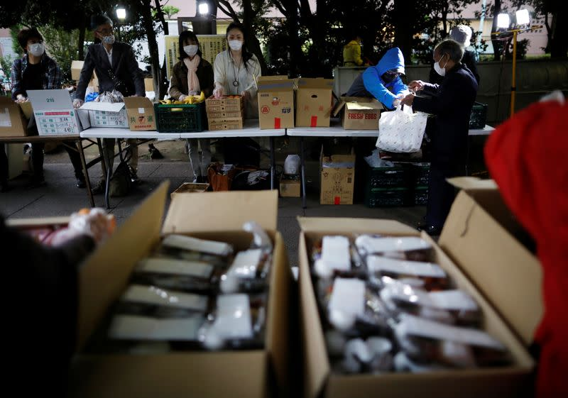 Volunteers take part in food aid handouts, as the spread of the coronavirus disease (COVID-19) continues in Tokyo