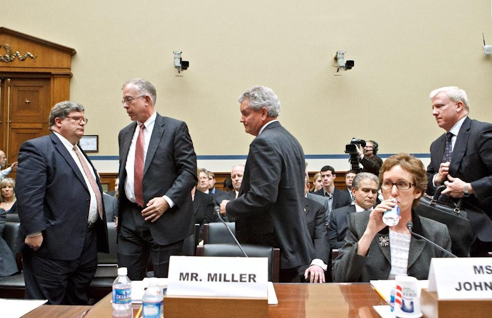 After declining to testify before a House Committee on Oversight and Government Reform hearing, former GSA official Jeff Neely, center, leaves the witness table at the order of the chairman, Rep. Darrell Issa, D-Calif., on Capitol Hill in Washington, Monday, April 16, 2012. Neely, formerly the regional commissioner of the Public Buildings Service, Pacific Rim Region, was involved in alleged lavish spending on a Las Vegas conference for the GSA. At far left is GSA Inspector General Brian Miller. Seated is former GSA Administrator Martha Johnson, who resigned over the scandal. (AP Photo/J. Scott Applewhite)