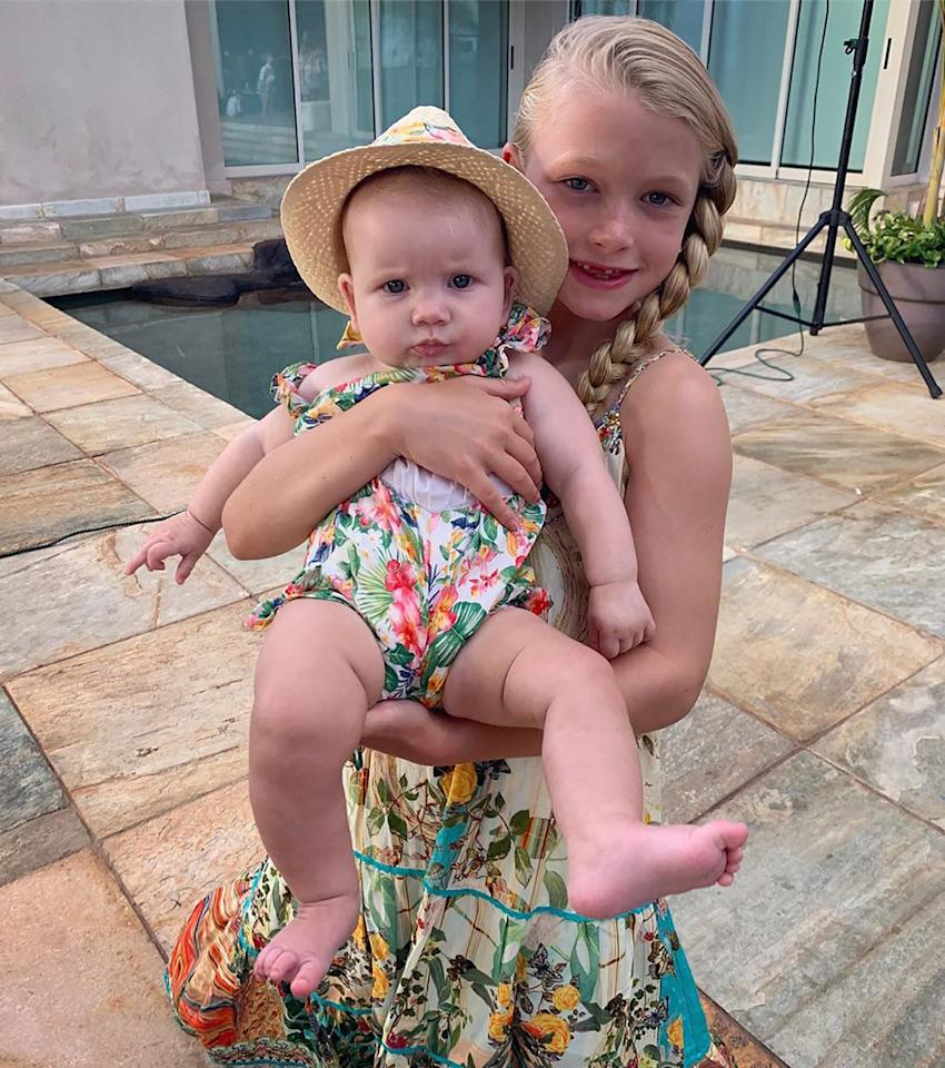 """Aloha from my girls 🌺,"" Simpson <a href=""https://www.instagram.com/p/B1cC86-gLD4/"">captioned</a> this summery photo of sisters Maxi Drew and Birdie Mae."
