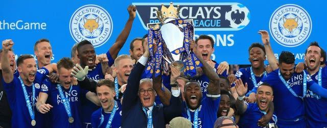 Leicester captain Wes Morgan and manager Claudio Ranieri lift the Premier League trophy in 2016, the club's first foray into the top six