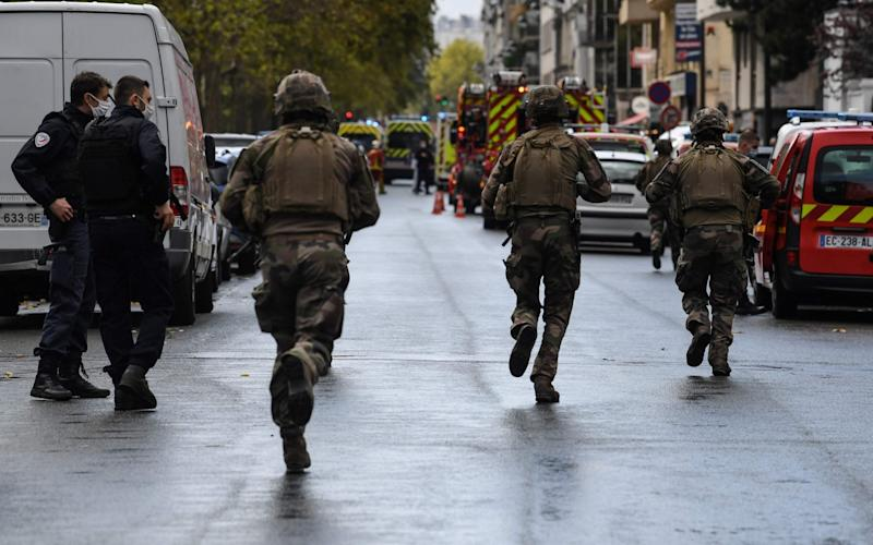 French soldiers descended on the site after two people were injured - ALAIN JOCARD/AFP