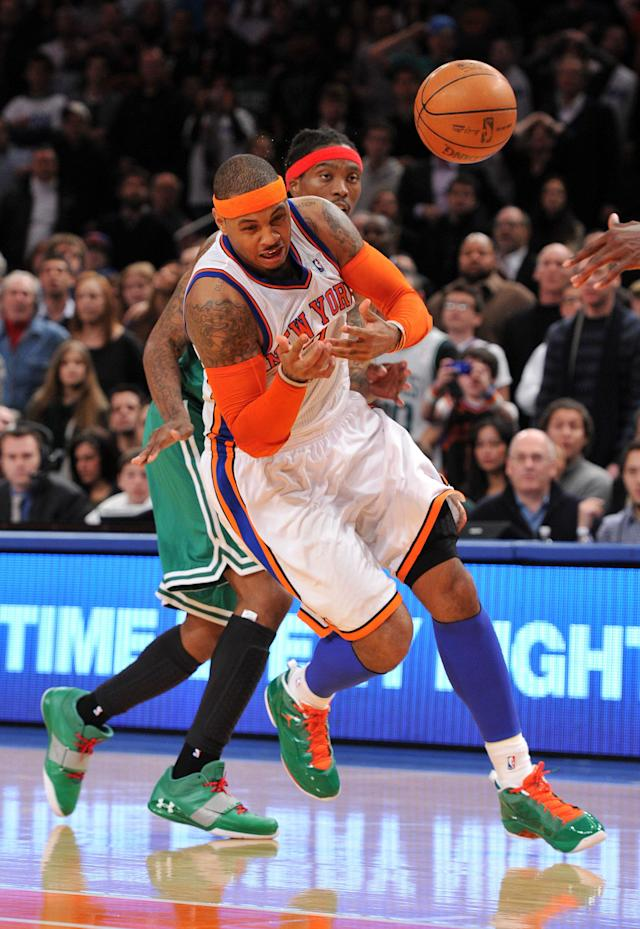 NEW YORK, NY - DECEMBER 25: Carmelo Anthony #7 of the New York Knicks is fouled by Marquis Daniels #4 of the Boston Celtics during the second half at Madison Square Garden on December 25, 2011 in New York City. NOTE TO USER: User expressly acknowledges and agrees that, by downloading and or using this photograph, User is consenting to the terms and conditions of the Getty Images License Agreement. (Photo by Christopher Pasatieri/Getty Images)
