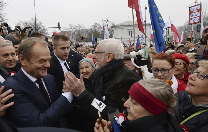 Donald Tusk, ex-Polish prime minister and president of the European Council, reacts with supporters after laying flowers by the statue of Marshal Jozef Pilsudski on the centenary of Polish independence in Warsaw, Poland, Sunday, Nov. 11, 2018. Pilsudski was the Polish leader who led Poland in regaining its lost statehood at the end of World War I after more than a century of rule by foreign powers. (AP Photo/Czarek Sokolowski)