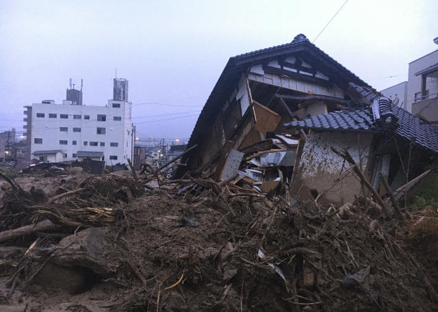 <p>Debris fills a small village following heavy rains on July 8, 2018, in Kuchita-Minami, Asakita-ku, Hiroshima, Japan. Searches continued Sunday night for dozens of victims still missing from the heavy rainfall that hammered southern Japan for the third straight day. (Photo: Haruka Nuga/AP) </p>