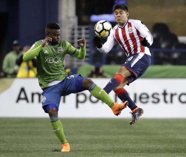 Sounders defender Waylon Francis, left, and Guadalajara midfielder Javier Lopez vie for possession during CONCACAF Champions League play on March 7. (AP)