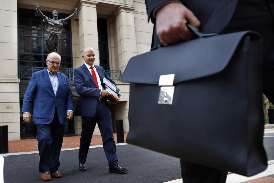 <p>Jay Nanavati, second from left, one of the lawyers for former Donald Trump campaign chairman Paul Manafort, leaves federal court after attending the Manafort trial in Alexandria, Va., Tuesday, Aug. 7, 2018. (Photo: Jacquelyn Martin/AP) </p>