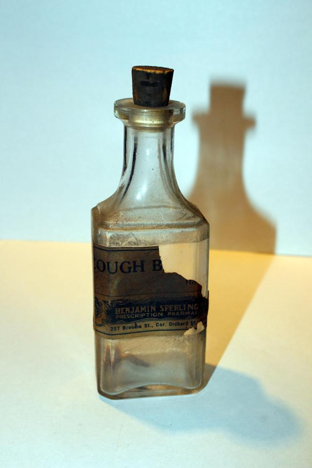 <p>This cough medicine bottle, from 257 Broome St. at the corner of Orchard St., was found in apartment in 1993. (Photo: Caters News) </p>