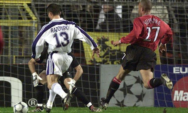 """<span class=""""element-image__caption"""">Better days for the Purple and Whites: Anderlecht's Tomasz Radzinski runs beside Manchester United's Mikael Silvestre in the 2000-01 Champions League.</span> <span class=""""element-image__credit"""">Photograph: Yves Herman/Reuters</span>"""