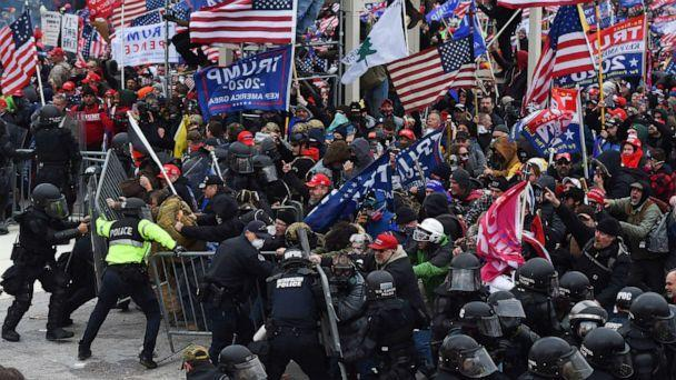 PHOTO: Supporters of President Donald Trump clash with police and security forces as they push barricades to storm the U.S. Capitol in Washington, D.C., on Jan. 6, 2021. (Roberto Schmidt/AFP via Getty Images)