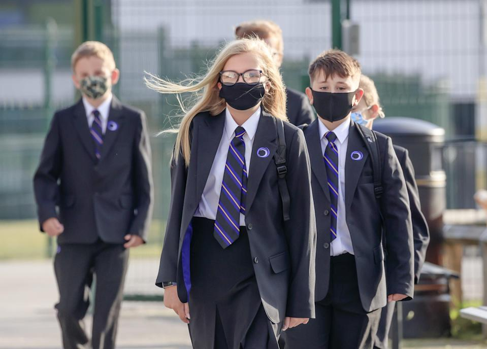 <p>Pupils wear masks at Outwood Academy Adwick in Doncaster</p> (PA)