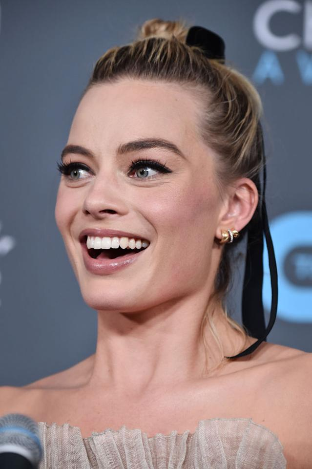 <p>Margot Robbie looks youthful and fresh at the Critics' Choice Awards, sporting a chic updo adorned with a simple black velvet ribbon. (Photo: Frazer Harrison/Getty Images) </p>