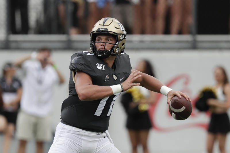 Central Florida quarterback Dillon Gabriel throws a pass against Stanford during the first half of an NCAA college football game, Saturday, Sept. 14, 2019, in Orlando, Fla. (AP Photo/John Raoux)