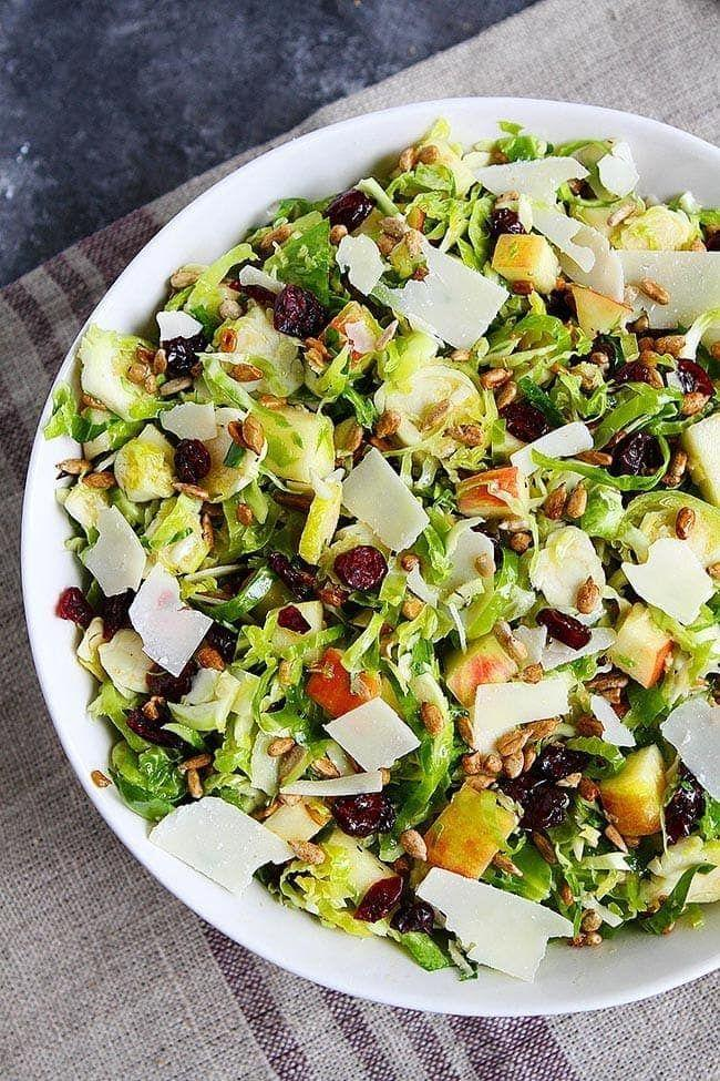 """<p>For this recipe, Maria Lichty turns raw Brussels sprouts into a fresh, crunchy salad. It's the perfect side dish to balance all the rich food on your Thanksgiving plate!</p><p><strong>Get the recipe from <a href=""""https://www.twopeasandtheirpod.com/shaved-brussels-sprouts-salad/"""" rel=""""nofollow noopener"""" target=""""_blank"""" data-ylk=""""slk:Two Peas & Their Pod"""" class=""""link rapid-noclick-resp"""">Two Peas & Their Pod</a>.</strong></p><p><strong><a class=""""link rapid-noclick-resp"""" href=""""https://go.redirectingat.com?id=74968X1596630&url=https%3A%2F%2Fwww.walmart.com%2Fbrowse%2Fhome%2Fmandolines-slicers%2F4044_623679_133020_4496646_6299933%3Fadid%3D22222222254421113917%26wmlspartner%3Dwmtlabs%26wl0%3Db%26wl1%3Dg%26wl2%3Dc%26wl3%3D311995544828%26wl4%3Daud-430887228898%253Adsa-759506286232%26wl5%3D9004342%26wl7%3D9073493%26veh%3Dsem%26gclid%3DCjwKCAjw3_KIBhA2EiwAaAAlilGcy3cWoQD7wkYbtIDcbCU64naPGis6GIcZLyJwDd7n-oXcVF77FBoCmBsQAvD_BwE%26gclsrc%3Daw.ds&sref=https%3A%2F%2Fwww.thepioneerwoman.com%2Ffood-cooking%2Fmeals-menus%2Fg37328783%2Fbrussels-sprouts-recipes%2F"""" rel=""""nofollow noopener"""" target=""""_blank"""" data-ylk=""""slk:SHOP MANDOLINES"""">SHOP MANDOLINES</a><br></strong></p>"""