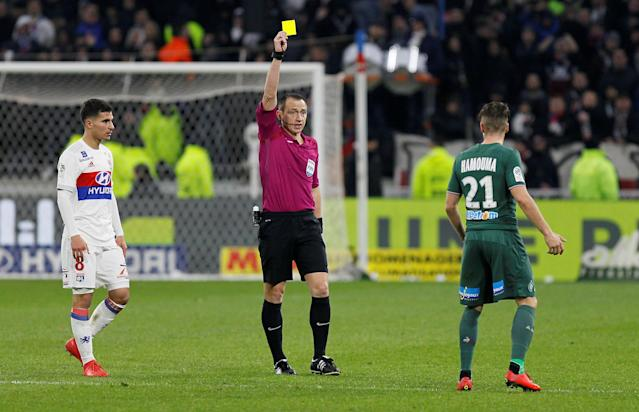 Soccer Football - Ligue 1 - Olympique Lyonnais vs Saint-Etienne - Groupama Stadium, Lyon, France - February 25, 2018 St Etienne's Romain Hamouma is shown a yellow card by referee Ruddy Buquet REUTERS/Emmanuel Foudrot