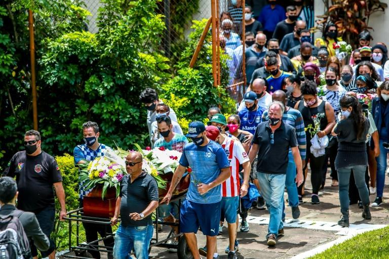 Relatives and friends of Joao Alberto Silveira Freitas, who died after being beaten by white security agents in a supermarket, walk with his coffin in Porto Alegre, Brazil, on November 21, 2020