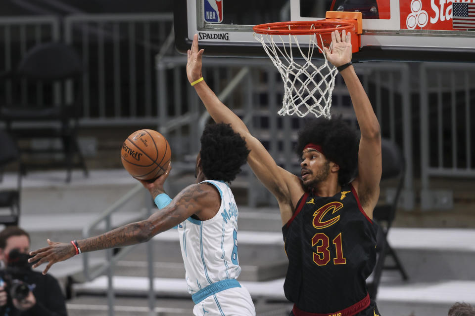 Charlotte Hornets forward Jalen McDaniels, left, drives to the basket against Cleveland Cavaliers center Jarrett Allen during the first quarter of an NBA basketball game in Charlotte, N.C., Wednesday, April 14, 2021. (AP Photo/Nell Redmond)