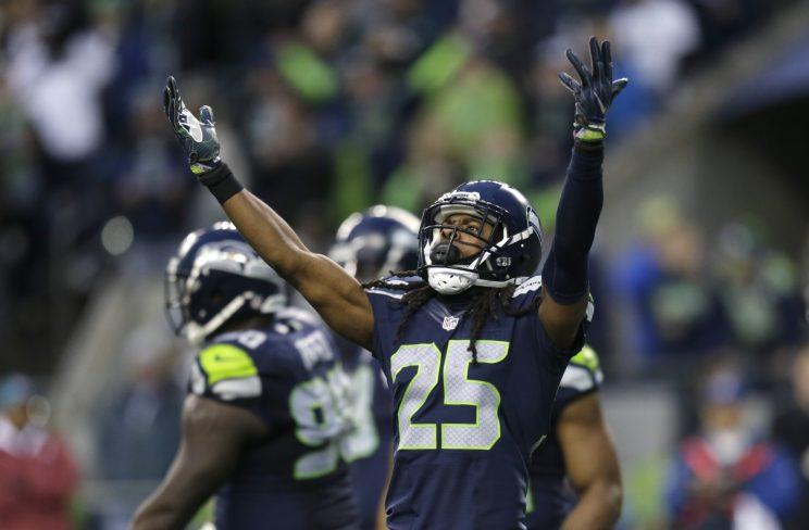 Richard Sherman supported a high school honors student's college aims. (AP_