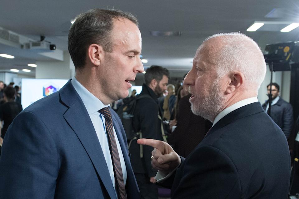Foreign Secretary Dominic Raab (left) and shadow transport secretary Andy McDonald exchange views at the Octagon in Sheffield, South Yorkshire, after leaders of four major parties took part in the BBC Question Time Leaders' Special. (Photo by Stefan Rousseau/PA Images via Getty Images)