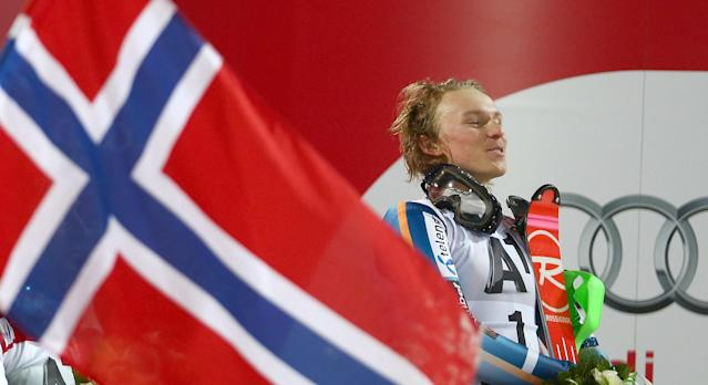 dFirst place Henrik Kristoffersen of Norway celebrates on the podium at the end of an alpine ski men's World Cup Night Slalom in Schladming, Austria, Tuesday, Jan. 28, 2014. (AP Photo/Giovanni Auletta)