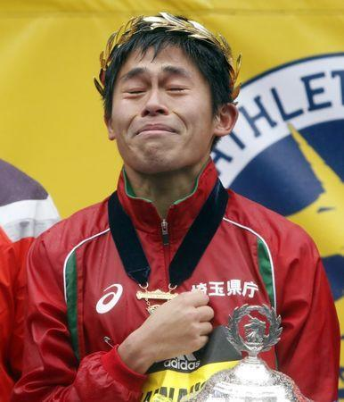 Apr 16, 2018; Boston, MA, USA; Yuki Kawauchi of Japan closes his eyes as he listens to his National Anthem after winning the 2018 Boston Marathon. Mandatory Credit: Winslow Townson-USA TODAY Sports