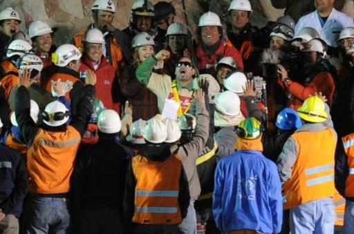 In this file photo taken on October 13, 2010, Chilean miner Mario Sepulveda (C with sunglasses) celebrates after being brought to the surface