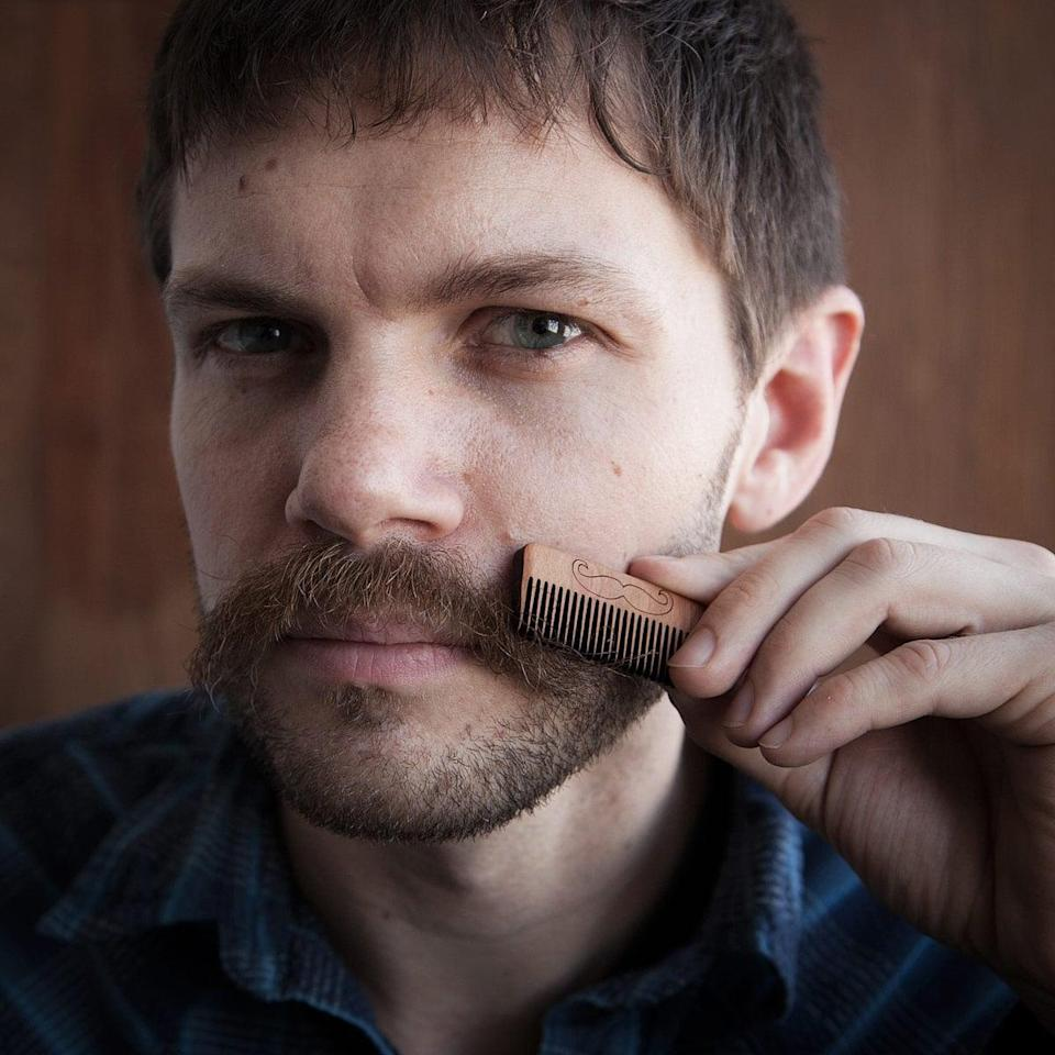<p>Make sure your guy keeps his facial hair in check with this <span>wooden whisker comb</span> ($16). </p>