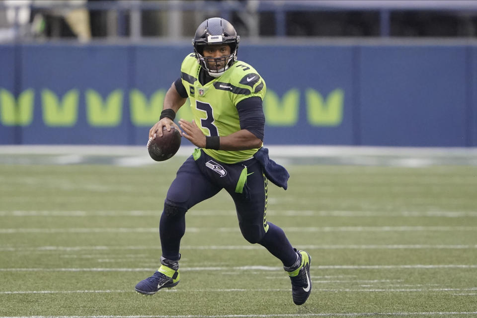 FILE - In this Oct. 11, 2020, file photo, Seattle Seahawks quarterback Russell Wilson looks for a receiver during the first half of the team's NFL football game against the Minnesota Vikings in Seattle. Wilson and his Grammy-winning wife, pop singer Ciara, are putting their money and celebrity behind rebranding a charter school, which advocates hope will boost the troubled Washington state charter school sector that has suffered from enrollment problems after years of legal challenges. (AP Photo/Ted S. Warren, File)
