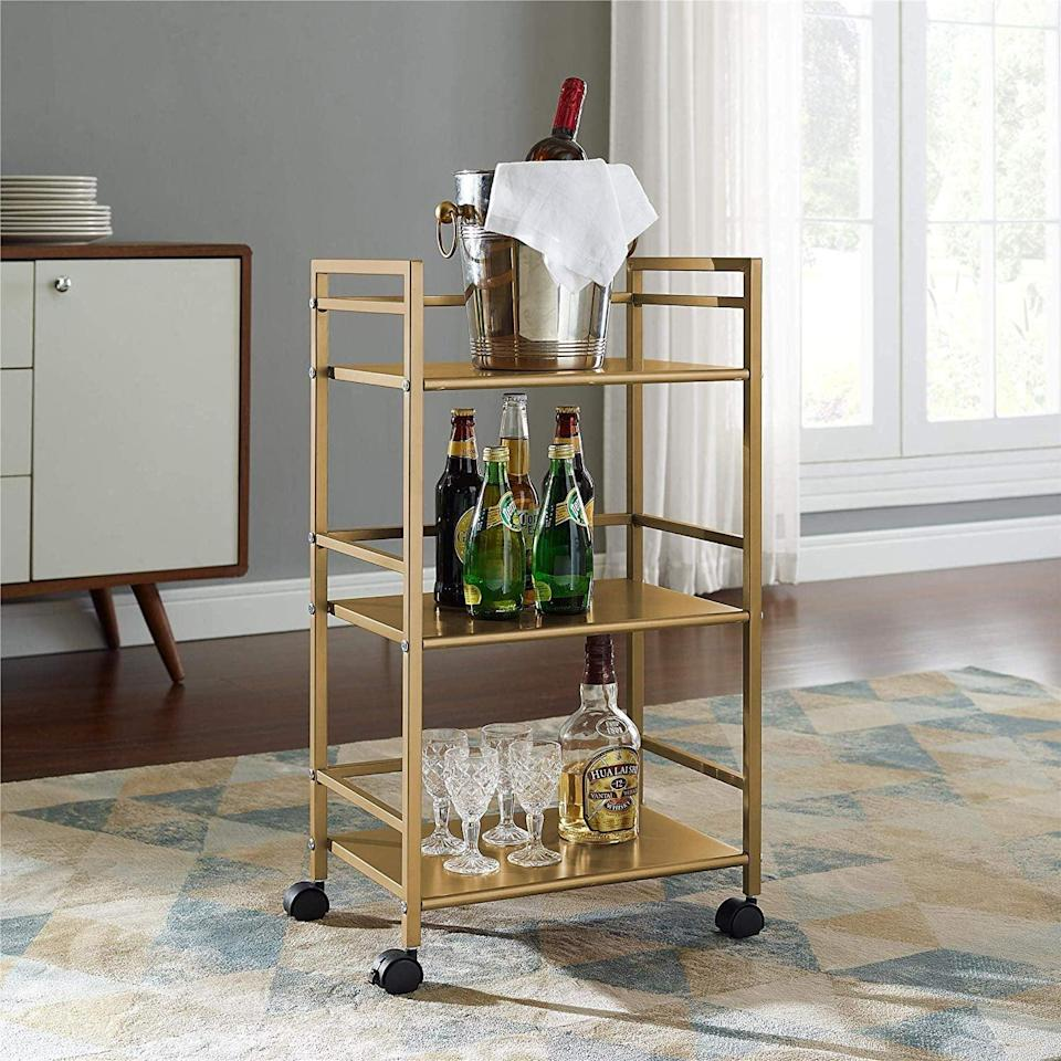 <p>Everyone will want to know where you got this <span>Novogratz Helix Utility Cart</span> ($57) from.</p>
