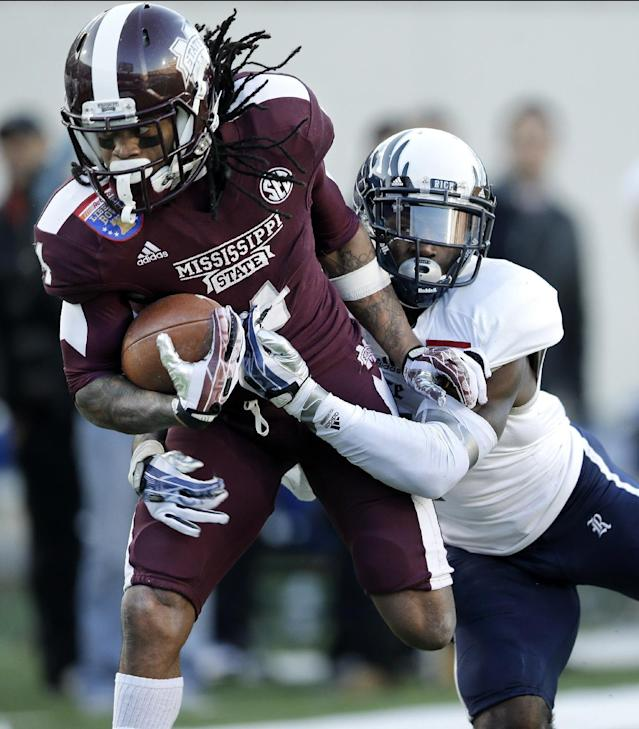 Mississippi State wide receiver Jameon Lewis, left, is brought down at the 2-yard line by Rice safety Julius White, right, in the second quarter of the Liberty Bowl NCAA college football game on Tuesday, Dec. 31, 2013, in Memphis, Tenn. Lewis gained 35 yards on the play. (AP Photo/Mark Humphrey)