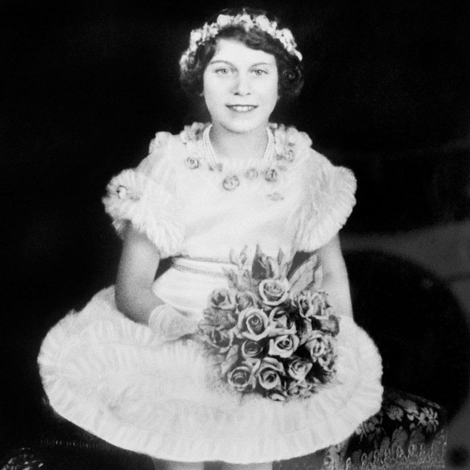 <p>The young princess poses with a bunch of flowers (PA Archive) </p>