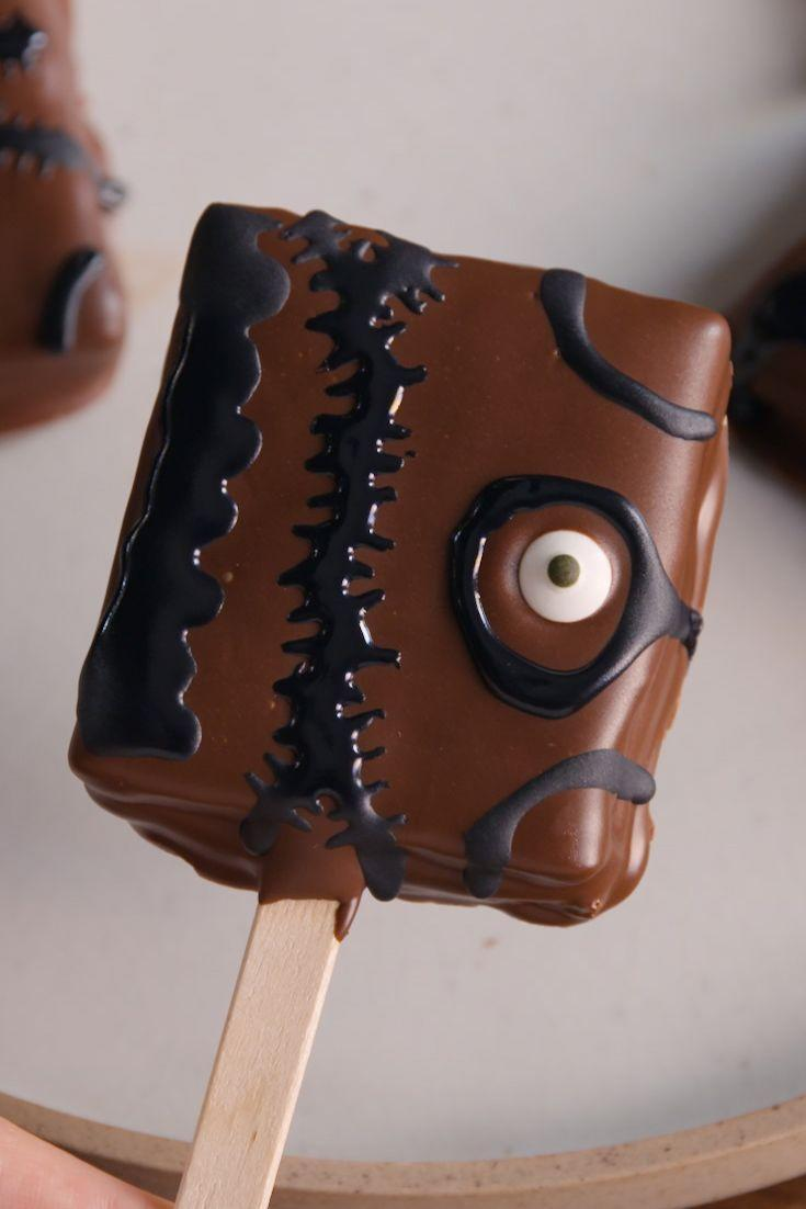 "<p>Don't skip the candy eyes!</p><p>Get the recipe from <a href=""https://www.delish.com/cooking/recipe-ideas/recipes/a49584/hocus-pocus-inspired-smores-pops-recipe/"" rel=""nofollow noopener"" target=""_blank"" data-ylk=""slk:Delish"" class=""link rapid-noclick-resp"">Delish</a>.</p>"