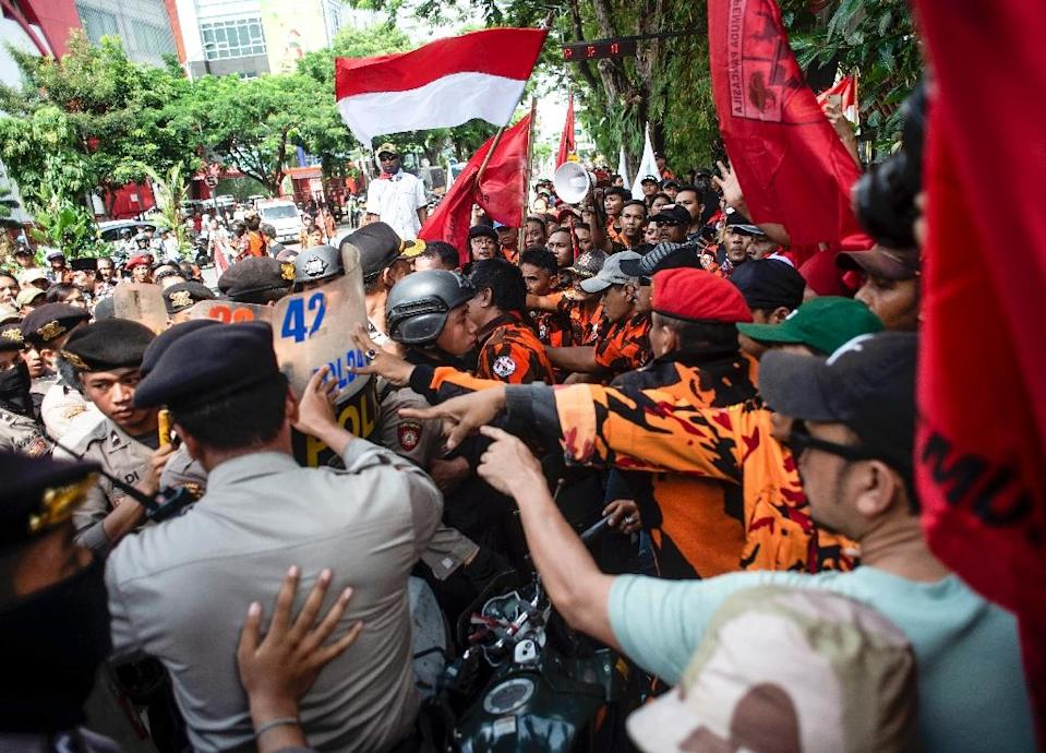 Jakarta keeps a tight grip on the resource-rich region, which experienced several spasms of violence this summer including the killing of three local people, allegedly by rebels (AFP Photo/JUNI KRISWANTO)