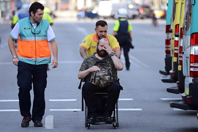 <p>An injured passenger is taken away in a wheelchair from a train station in Barcelona, Spain, Friday, July 28, 2017. (Photo: Adrian Quiroga/AP) </p>
