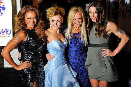 """FILE PHOTO: Spice Girl members Melanie Brown (L-R), Geri Halliwell, Emma Bunton and Melanie Chisholm arrive for the premiere of the musical """"Viva Forever!"""", based on the music of the Spice Girls, in central London December 11, 2012. REUTERS/Toby Melville/File Photo"""