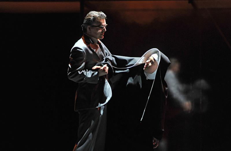 "The photo provided by Deutsche Oper am Rhein in Duesseldorf, western Germany, shows Markus Eiche, left, as Wolfram and Elisabet Strid as Elisabeth in a scene of the the opera 'Tannhaeuser' during the dress rehearsal on April 30, 2013. The modern production of Richard Wagner's opera Tannhauser has caused a stir in Germany because of Nazi-themed scenes showing people dying in gas chambers and a family getting their heads shaved and executed. A spokeswoman for the Dusseldorf opera house said Tuesday that members of the audience ""booed and were shocked"" by Saturday's, May 3, 2013 opening performance. (AP Photo/Deutsche Oper am Rhein, Hans Joerg Michel) Mandatory Credit"