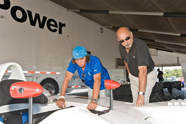 CHICAGO, IL - SEPTEMBER 13: Racing legend Bobby Rahal and PGA TOUR player Rickie Fowler look over a BMW American Le Mans Series prototype racer at the kick-off to the BMW Championship, the third leg of the PGA TOUR play-offs at Autobahn Racetrack on September 13, 2011 in Joliet, Illinois. (Photo by Timothy Hiatt/Getty Images for BMW)