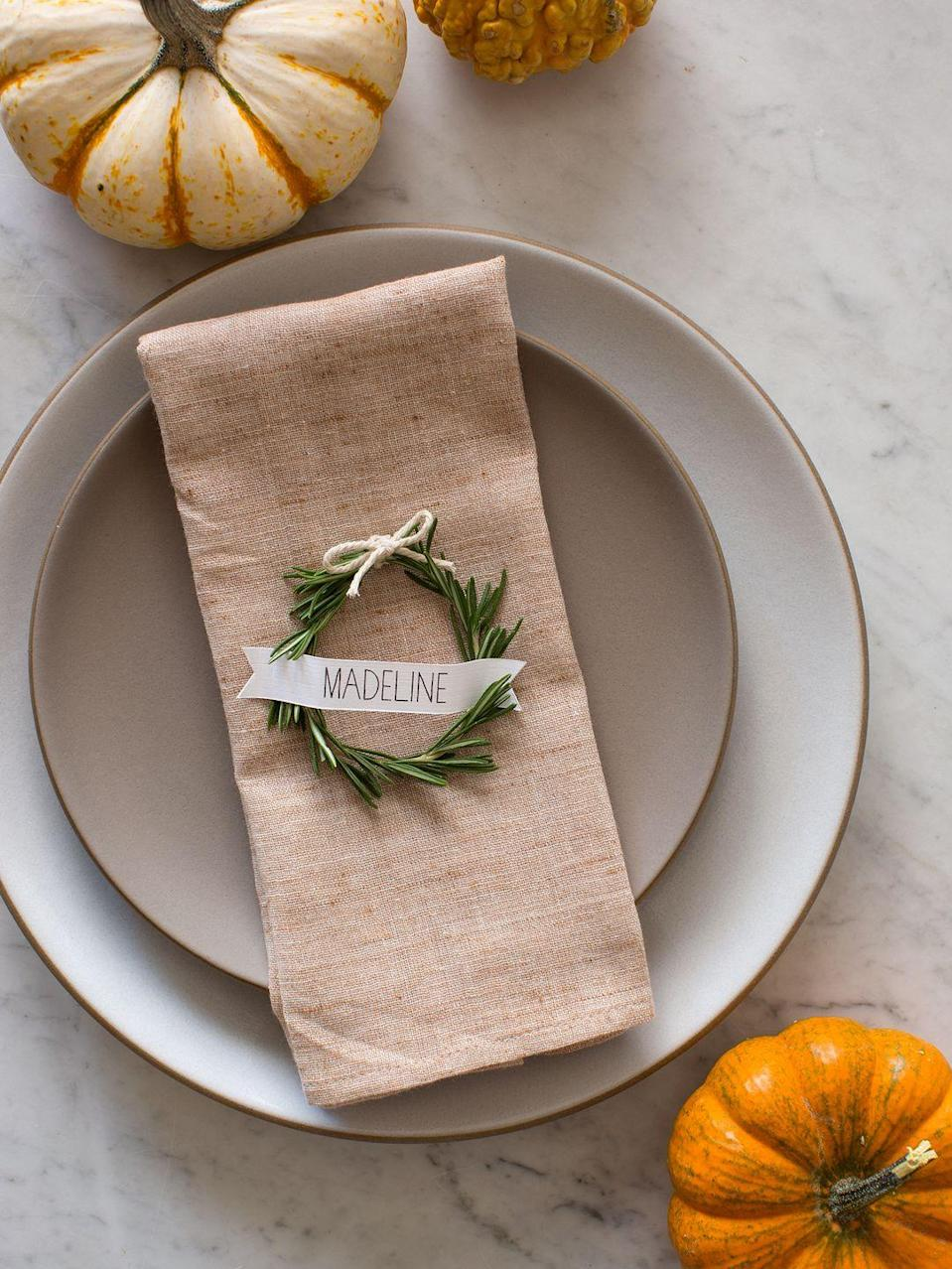 "<p>These perfectly circular wreaths will give your Thanksgiving table an elegant touch. </p><p><strong>Get the tutorial at <a href=""http://www.spoonforkbacon.com/2017/12/rosemary-wreath-place-cards/"" rel=""nofollow noopener"" target=""_blank"" data-ylk=""slk:Spoon Fork Bacon"" class=""link rapid-noclick-resp"">Spoon Fork Bacon</a>.</strong></p><p><strong><a class=""link rapid-noclick-resp"" href=""https://www.amazon.com/Silverware-LIANYU-20-Piece-Stainless-Dishwasher/dp/B07FFQ9RHK?tag=syn-yahoo-20&ascsubtag=%5Bartid%7C10050.g.1538%5Bsrc%7Cyahoo-us"" rel=""nofollow noopener"" target=""_blank"" data-ylk=""slk:SHOP COPPER FLATWARE"">SHOP COPPER FLATWARE</a><br></strong></p>"